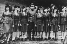 Female camp guards with their SS superiors at Auschwitz.