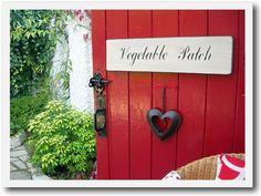 Vintage garden sign for a cottage garden