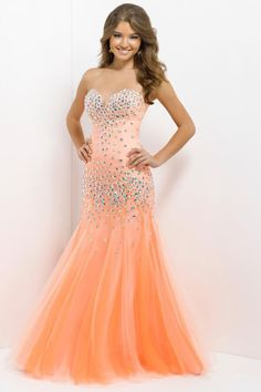 80d2d3f4e7c Start out searching for your perfect long maxi strapless light orange prom  dress by flipping through