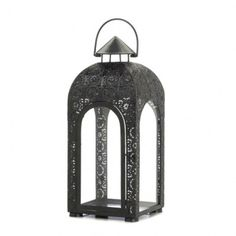 "<p>Make a spectacle of simple candlelight with this beautiful black iron candle lantern. The cutout medallion design is highlighted by the arched glass panels that give a clear view of this large lanterns interior. Features a top hanging loop. Candle not included. 20"" high with handle. </p>"