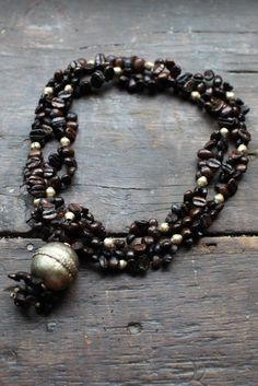 Dark Roasted Coffee Bean Necklace - From Ethiopia to you. $25.00, via Etsy.