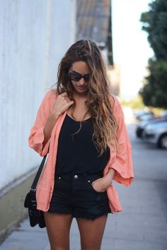 Black on black with a colorful cardigan. Cute and mysterious. Love it!