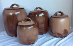 Four-piece Canister Set (#25 series) by Frankoma in Brown Satin. These were made 1960-74, although the canisters' lid design was changed in later years.