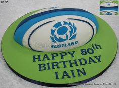 Less Scrum, more scrumptious... Gilbert rugby ball shaped novelty cake decorated with the Scottish rugby unions crest. Standard Gilbert rugby ball logo on the reverse of the cake. Any team any colours