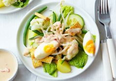 Spoon homemade peanut sauce on top of assorted vegetables in this Indonesian salad recipe.