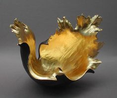 """Kay Lynne Sattler ~  """"Emerging Radiance"""". Kay Lynne Sattler makes pit fired coil pots with gold leaf.  Inspired by the volcanic forms of her home in Hawaii."""