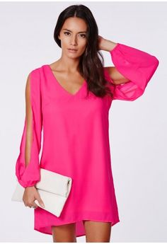 fuchsia frilled fancy, perfect for working AM to PM. The open sleeve detail is sassy and chic, and the chiffon feel fabric is spot on. Style with a pair of strappy suede heels and an oversized clutch.  Conc...