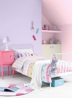 Pretty girls bedroom painted with Crown matt emulsion in Rodeo Drive (purple), Fairy Dust (pale pink), Apple Mist (green) and Pink Sugar (darker pink)