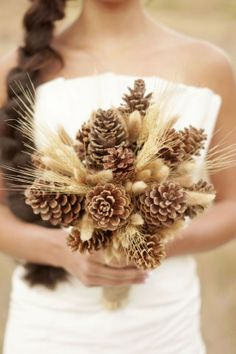 Pine cone wedding bouquet. Interestingly lovely. Needs a flower