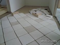 Putting the stone flooring in the hall.