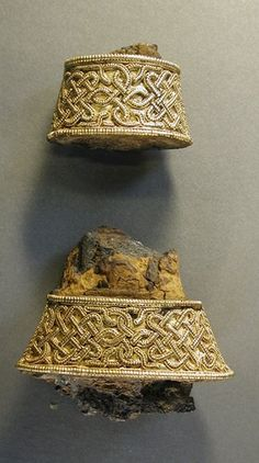 Wide and narrow hilt collars, with remnants of iron sword tang, from a set of 5 gold and garnet sword hilt fittings. Early Anglo-Saxon, early c. Medieval Jewelry, Viking Jewelry, Ancient Jewelry, Medieval Art, Anglo Saxon History, British History, Historical Artifacts, Ancient Artifacts, Sword Hilt