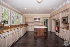 Beautifully remodeled home at 1667 Cross Bridge Place in Thousand Oaks. Chefs delight island kitchen features gorgeous granite and limestone, custom cabinetry and stainless steel appliances