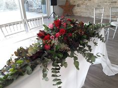 Large ceremony table arrangement for wedding on New Year's Eve