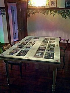 """Previous pinner: """"Repurposed - I created this 'Keepsake Dinning Table' by re-purposing a set of french doors and a bullet-proof glass door from a bank demolition. We've filled the panes with photos, trinkets and other pieces of our lives. Refurbished Furniture, Repurposed Furniture, Skeleton Key Crafts, Door Dining Table, Dining Room, Vintage Doors, Antique Doors, French Country Dining, Old Doors"""