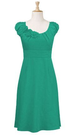 Simple shape, lovely vibrant color, and small feminine details at the neckline make this dress.