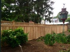 Red Cedar Wood Privacy Fence with Diagonal Lattice Topper encloses this back yard