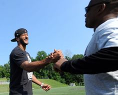 San Francisco 49ers quarterback Colin Kaepernick, left, shakes hands with St. Luke's football coach Noel Thomas during his visit to the St. Luke's School in New Canaan, Conn., Saturday afternoon, July 12, 2014. Kaepernick visited the school on behalf of the Children of Fallen Patriots Foundation that provides college scholarships and educational counseling to military children who have lost a parent in the line of duty. The foundation was founded by husband and wife, David and Cynthia Kim of…