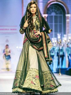 Miss Universe Canda 2012 Sahar Biniaz showcases a creation by designer Mandira Wirk during India Bridal Fashion Week '13, held at Grand Hyat...