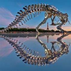 Giant Chrome T-Rex Installed on Seine Rive in Paris by Philippe Pasqua