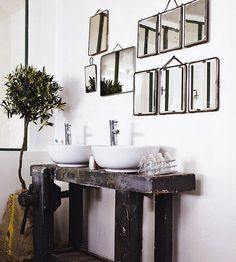 Repurposed wood bench turned vanity. Even has the vice
