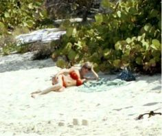 1990-04-09 Diana sunbathes on the beach on Necker Island
