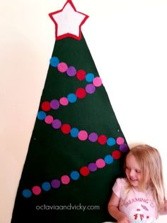Felt Christmas Tree - but do it with lots of different shaped felt ornaments and let kids play decorating the tree (on the wall or on individual big pieces of cardboard in a special center)