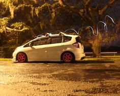 Honda fit Ge8 with pink wheels.