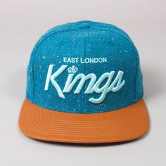 King Apparel ' E.L.K Script' x Starter Strapback - Blue Tweed Back by popular demand, the East London Kings - a truly deserving title.Limited Edition Starter collaboration Snapback cap. The ONLY UK brand with the original coveted Starter Black Label premium affiliation from New York.Blue speckled tweed crown with light blue 3D stitching, with light blue Starter branding on the rear.Brown leather peak with black leather strap adjuster