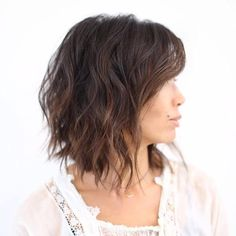 It's been said time and time again, but there is something so incredibly flattering and sexy about adding soft waves to your hair. As with this choppy cut, the key is to make them look undone or lightly tousled, which gives them a more natural look.