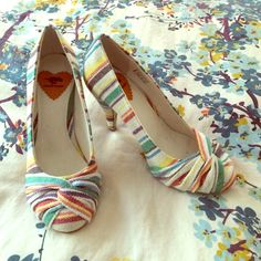 Rocket Dog Heels New in box stripe on canvas with twist front at top a rounded closed toe heel.  Goes with anything.  Off white ground with red, green, blue, yellow, and purple variated stripes. No trades- firm on price again, these are new and sold out everywhere! Rocket Dog Shoes Heels