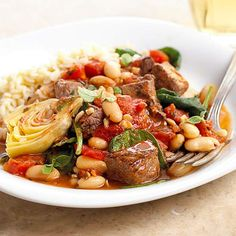 Add Greek flavors to your dinner with this slow-cooker Lamb with Spinach and Artichokes. More of our favorite slow-cooker recipes: http://www.bhg.com/recipes/slow-cooker/soup-chili/winter-slow-cooker-recipes/?socsrc=bhgpin111912greeklamb#page=17