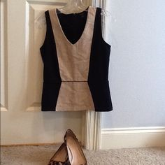 Ann Taylor sleeveless peplum top Ann Taylor sleeveless peplum top, linen center in front, very perfect for suits/work Ann Taylor Tops Blouses