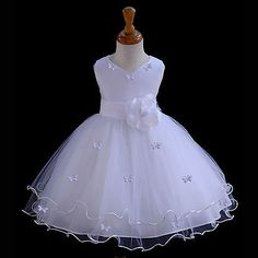 White Flower Girl butterfy tulle dress 20 colors by ekidsbridalusa The skirt has 4 layers, top and layers is made of elegant tulle with a rattail edge. The elegant upper bodice feature is made out of Satin Poly. Baptism Dress, Christening Gowns, Little Girl Dresses, Girls Dresses, Pageant Dresses, Party Dresses, Robes Tutu, Wedding Flower Girl Dresses, Dress Wedding