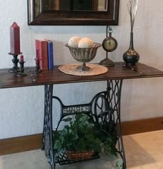 We picked up a nice antique Singer treadle sewing machine and crafted this table with the base. We love it!