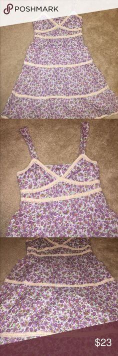 Free People Purple Floral Crochet Sundress Super cute Sundress from Free People . It is light blue background with lavender flowers with taupe crochet trim throughout. It ties in the back. It is a size 10 but runs small was worn when a size 8 the bust area is approximately 16 inches. Free People Dresses