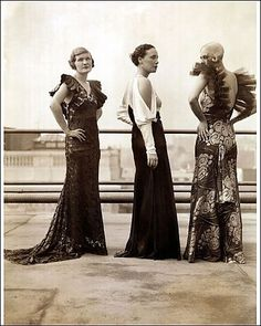 Three women in evening gowns, c1930s. Love the open shoulders... on Twitpic