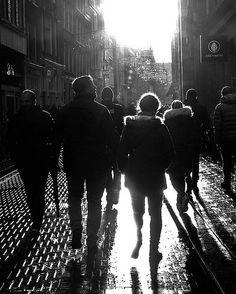 Walk towarts the Light  #Amsterdam #light #photography #Netherlands #streetphotography #Spiegelung #Reflection #blackandwhite #people #Menschen #Sun