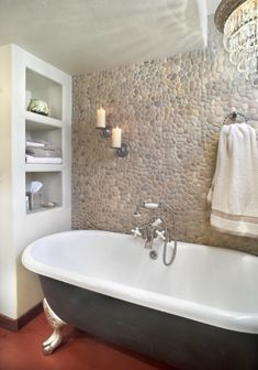 Pebble tile is a great way to add rustic texture to a wall or floor!   Here they used Java Tan Pebble tile on the bathroom wall.  https://www.pebbletileshop.com/products/Java-Tan-Pebble-Tile.html#.VZ2IrflViko