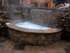 I want this heated waterfall sunken hot tub. #absolutejoy Oakville, Sunken hot tub with sheer descent, heated waterfall.