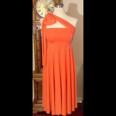 One gorgeous dress worn tons of different ways! The color of this dress is gorgeous and perfect for spring or summer! Stretchy comfortable material that can accommodate a variety of sizes/body types! NWT! Can be worn so many different ways! Dresses