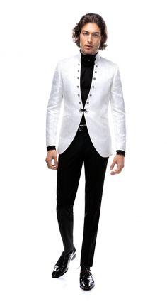 Costumul din imagine este unul de mire, în stil tunică, realizat la comandă de o echipă de designeri și croitori profesioniști, maiștrii în domeniul croitoriei pentru bărbați. Sacoul de la costum a fost accesorizat într-un stil aparte, având în locul reverelor 12 accesorii din cristale Swarovski și închiderea cant în cant (brandenburg). Modelul se confecționează în urma unei programări telefonice și se poate personaliza după specificațiile clientului. Sherwani, Nasa, Costumes, Blazer, Jackets, Wedding, Style, Fashion, Suits
