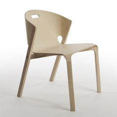 This chair by industrial designer Benjamin Hubert features a T-shirt-shaped piece of plywood curled smoothly into its solid ash frame.