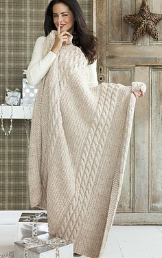 Bulky wool -- quick to knit, cozy, especially in this oatmeal, cabled pattern easy enough for advanced beginner. . .
