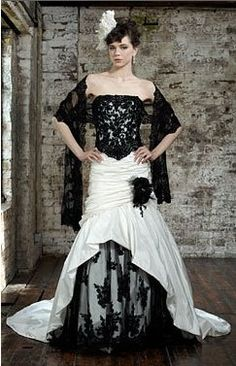 Take off train and wrap and this definately would look amazing on attendants in green velvet lilac lace, and pink organza. Especially on the ones with arm length tatoos! Unique Gothic Steampunk Wedding Gown by IdoTakeTwo on Etsy, $425.00