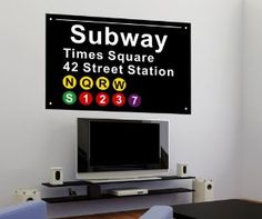 Cool! A New York subway sign turned wall decal. Great for a New York-themed bedroom or just a sleek urban look.