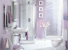 Bathroom Decorating Ideas Lavender light purple linens pair well with a white alcove bathtub