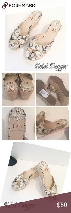 """Kelsi Dagger Bianca Snake Print Shoes 7 1/2 NWT Kelsi Dagger Snake Print Wedges Shoes 7 1/2. Gorgeous. Tts 2.5"""" approx wedge 1.5"""" approx front purchased at Neiman Marcus. Brand New casual slip on espadrille platform sandal with crisscross straps. Barely noticeable manufacture glue on insole. See pic Braided rope covered wedge. Synthetic sole. Kelsi Dagger Shoes Wedges"""
