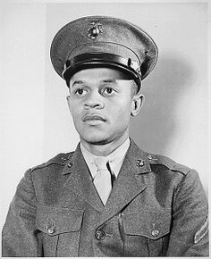 """""""Breaking a tradition of 167 years, the U.S. Marine Corps started enlisting Negroes on June 1, 1942. The first class of 1,200 Negro volunteers began their training 3 months later as members of the 51st Composite Defense Battalion at Montford Point, a section of the 200-square-mile Marine Base, Camp Lejeune, at New River, NC. The first Negro to enlist was Howard P. Perry shown here."""" Credit: National Archives."""