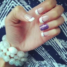 Classic French tip with an accent of pretty purple glitter!