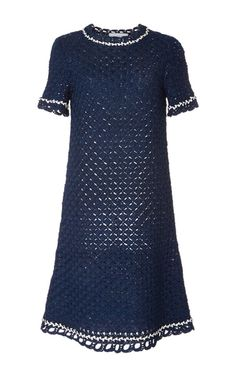 Designers Allyson Spencer and Vladimir Teriokhin deliver innovative, personality-filled sweaters entirely knit or crocheted by hand in New York. This **Spencer Vladimir** dress features an A-line silhouette in navy silk with white trim and buttons.